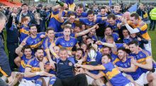 Maghery players celebrate being crowned Armagh Champions 2016. Photo: Inpho