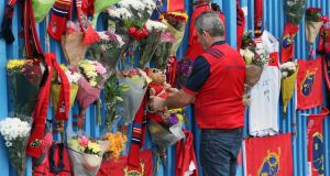 Munster Rugby fans place tributes outside Thomond Park in Limerick after the death of head coach Anthony Foley. Photograph: Niall Carson/PA Wire