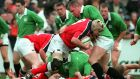 Anthony Foley of Munster is tackled by Victor Costello of the rest of Ireland during a friendly in 2001. Photo: Andrew Paton/Inpho