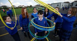 Conor Meehan and classmates enjoy 'Hoops' during exercise time St Paul's primary school in Abbeylands in Navan. Photograph: Nick Bradshaw
