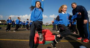 Mr McLoughlin and pupils during their exercise time at St Paul's primary school in Abbeylands in Navan. Photograph: Nick Bradshaw