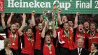 Munster Players celebrate as their captain, Anthony Foley, lifts the trophy following victory during the Heineken Cup final between Munster and Biarritz Olympique  on May 20th, 2006, in Cardiff's  Millennium Stadium. Photograph:  David Rogers/Getty Images
