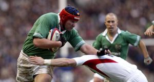 Anthony Foley hands off a tackle from Iain Balshaw at Twickenham in 2004. Photograph: Billy Stickland/Inpho