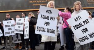 Teachers with the ASTI protest outside Leinster House. Photograph: Eric Luke/The Irish Times