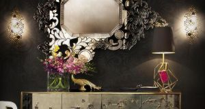 Set a dark but desirable scene with these pieces by American superluxe brand By Kroket (bykoket.com) which features an Addicta Venetian-style mirror, €9,700, the aptly named Spellbound antique glass-fronted sideboard, €19,130, also available in a black and gilt option; Eternity sconces, €1370 each and Gem table lamp, €2,970.
