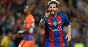 Lionel Messi scored a hat-trick as Barcleona punished Manchester City's errors at the Nou Camp. Photograph: Afp