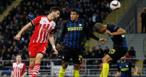 Shane Long was forced off injured as Southampton  were beaten 1-0 by Inter Milan. Photograph: Reuters
