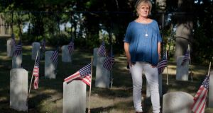 Beverly MacDonald at  the Sailors Home Cemetery in Quincy, Massachusetts, where 118 US sailors and marines who MacDonald says were mostly of Irish descent are buried.  Photograph: Kael Alford/Panos Pictures