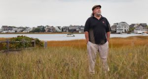 Brian Kelleher near his home on Plum Island, Massachusetts, where his family vacationed when he was a child.  Photograph: Kael Alford/Panos Picttures