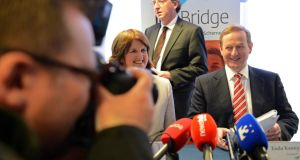 A bridge too far?: The Taoiseach, Enda Kenny, and the Minister for Social Protection, Joan Burton, at the launch of an independent evaluation of JobBridge. Photograph: Eric Luke