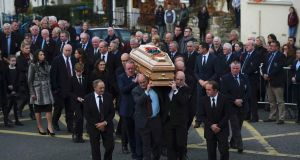 The coffin of Munster rugby coach Anthony Foley is carried from St. Flannan's Church after his funeral service in Killaloe, Ireland October 21st, 2016. Photograph: Clodagh Kilcoyne/Reuters