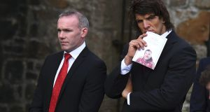 Former Munster rugby players John Kelly (L) and Donncha O'Callaghan arrive for the funeral service. Photograph: Clodagh Kilcoyne/Reuters