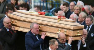 The coffin of Munster rugby coach Anthony Foley is carried from St Flannan's Church after his funeral service in Killaloe. Photograph: Clodagh Kilcoyne/Reuters