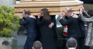 The coffin of Munster coach Anthony Foley is carried into St Flannan's Church by pallbearers for his funeral service in Killaloe. Photograph: PA