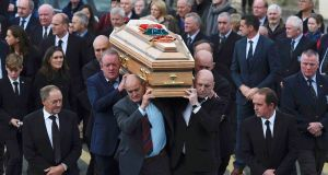 Mick Galwey, Peter Clohessy, Keith Wood and John Hayes carry the coffin of Munster rugby coach Anthony Foley from St Flannan's Church after his funeral service in Killaloe, Co Clare. Photograph: Clodagh Kilcoyne/Reuters
