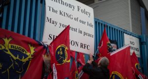A fan pays  tribute to Anthony Foley outside Thomond Park. Photograph:  by Eamon Ward