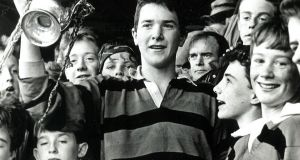 Captain Anthony Foley holds the trophy aloft after St Munchin's victory in the Munster Junior School's Cup  in 1989. Photograph courtesy of St Munchin's College