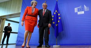 British prime minister Theresa May is welcomed by European Commission president Jean-Claude Juncker at the EC headquarters in Brussels, Belgium. Photograph: Reuters