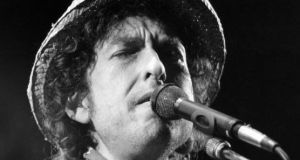 "Singer-songwriter Bob Dylan's continued silence over his Nobel honour has been denounced as ""impolite and arrogant"" by one of the members of the Swedish Academy that awarded him the prize. Photograph: AFP/Getty Images"