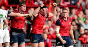 Munster's Donnacha Ryan, Billy Holland and Tommy O'Donnell celebrate winning a penalty try. Photo: Ryan Byrne/Inpho