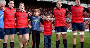 Tony and Dan Foley, sons of the late Anthony Foley sing with the Munster players after the game. Photo: Dan Sheridan/Inpho