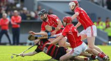 Ballygunner's Tim O'Sullivan is tackled by Passage's Darragh Lynch and Noel Connors. Photo: Ken Sutton/Inpho