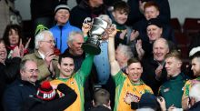Corofin's Alan Burke and Ciaran McGrath lift the cup. Photo: Tommy Grealy/Inpho