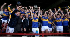 Patrickswell captain Thomas O'Brien lifts the cup. Photo: Donall Farmer/Inpho