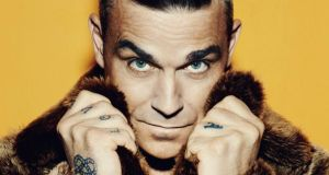 'It was the best of times and the worst of times,' says Robbie Williams of his bad-boy days. Photograph: Columbia Records/Sony Music