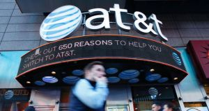 AT&T said the Time Warner deal would save $1 billion within three years of the takeover being completed. Photograph: Kena Betancur/AFP/Getty Images