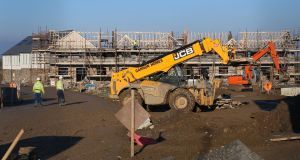 Houses under construction in Dublin: Developers do not have to sell part V property to the local authority and can offer long-term leasing on the homes instead.  Photograph: Niall Carson/PA Wire