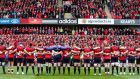 The Munster squad stand for a minute's silence for  Anthony Foley before Saturday's stirring victory over Glasgow. Photograph: Tommy Dickson/Inpho