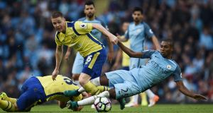 Everton's James McCarthy is tackled by Manchester City's during the English Premier League match between Manchester City and Everton at the Etihad Stadium in Manchester. Photo: PA