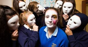 FACE OFF: Lauren McCausland fifth year (with face paint) surrounded by second year art students from St Mary's Secondary School, Glasnevin at the Art Teachers' Association of Ireland launch of the #stateoftheart campaign to raise awareness of the need for change in Leaving Certificate Art . Photograph: Naoise Culhane
