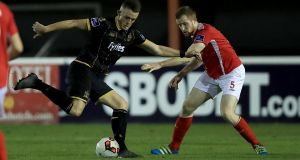 Dundalk's Michael O'Connor with Sean Hoare during St Pat's 5-2 win over the champions. Photogrpah: Inpho