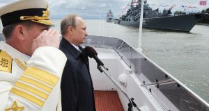 Russian president Vladimir Putin attends a ceremony marking Navy Day in Kaliningrad in July  2015. Photograph: Mikhail Klimentyev/AFP/Getty Images