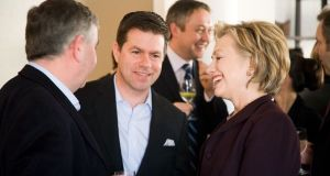 Teneo cofounder Declan Kelly (second from left) with Democratic presidential nominee Hillary Clinton: details of  firm's connections with the Clintons were revealed in emails leaked by Wikileaks