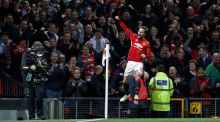Manchester United's Juan Mata celebrates scoring at Old Trafford. Photograph: Darren Staples/Reuters