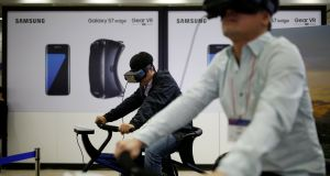 People try out Samsung Electronics' Gear VR: the world's top smartphone maker posted a 96 per cent plunge in third-quarter mobile earnings to 100 billion won ($87.63 million) from a year earlier.  Photograph: Kim Hong-Ji/Reuters