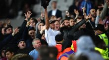Fans clash inside the stadium during the EFL Cup fourth round match between West Ham United and Chelsea at The London Stadium. Photo: Dan Mullan/Getty Images