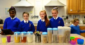 Sixth class students help serve the healthy breakfast club 'Rise 'n' Shine' and lunchbox initiative for pupils at St Eithne's in Edenmore, Raheny, Dublin. Photograph: Dara Mac Dónaill