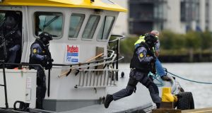 Emergency Response Unit gardaí arrive at Drogheda Port during a joint training exercise between the force and the Drogheda Port Company. Photograph: Dara Mac Dónaill/The Irish Times.