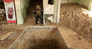 An Iraqi special forces soldier looks inside the entrance of a tunnel used by Islamic State militants in a restaurant in Bazwaya, east of Mosul, on Thursday. Photograph: Zohra Bensemra/Reuters