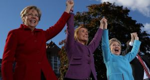 Senator  Elizabeth Warren (left), New Hampshire governor Maggie Hassan and democratic presidential nominee  Hillary Clinton greet supporters during a campaign rally at Saint Anselm College this week   in Manchester, New Hampshire. Photograph: Justin Sullivan/Getty Images