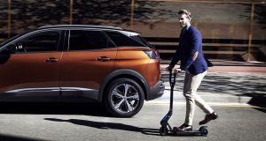Peugeot's accessories list for the 3008 features a foldable electric assisted push scooter and an foldable electric bicycle. Both can be plugged in and charged in the car's boot.