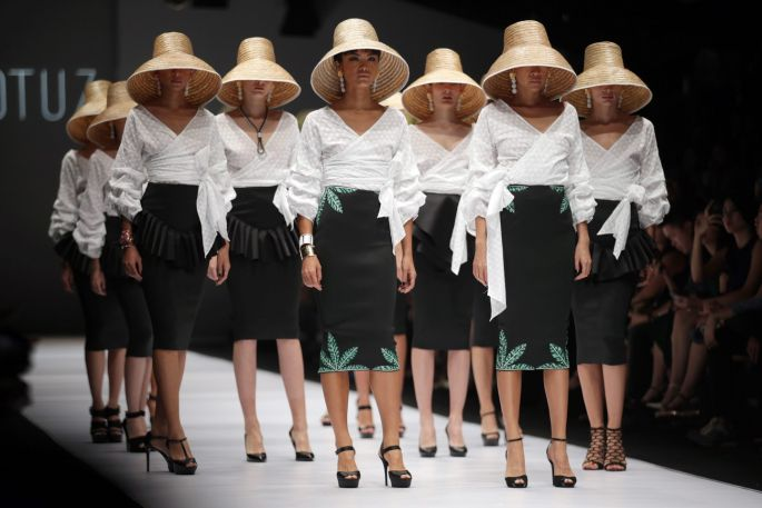 Images of the day jakarta fashion week models wear creations by indonesian designer lotuz during jakarta fashion week 2017 stopboris Image collections