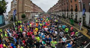Thousands of runners on  Fitzwilliam Street Upper for the start of last year's Dublin Marathon. The expected figure of 19,500 runners this year is well up on last year's 13,000 total. Photograph: Cathal Noonan/Inpho