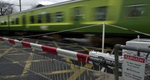 A Dart passes the Merrion Gates railway crossing in Dublin 4. File photograph: Eric Luke/The Irish Times