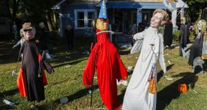 Democratic candidate Hillary Clinton is depicted as an angel, Republican candidate Donald Trump as a devil, with former vice-president Dick Cheney looking on, at a Halloween display in Georgia. Photograph: Erik S Lesser/EPA