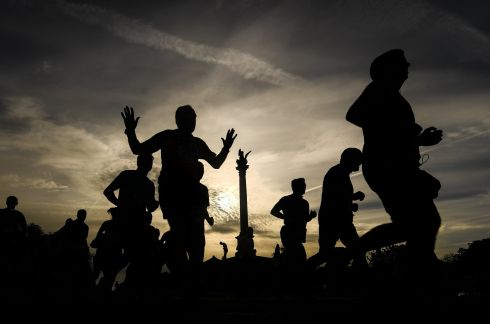 Runners making their way past the Pheonix Park monument during the SSE Airtricity Dublin Marathon. Photograph: Ramsey Cardy/Sportsfile